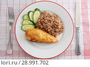 Купить «Chicken Kiev with buckwheat porridge», фото № 28991702, снято 8 июля 2018 г. (c) Stockphoto / Фотобанк Лори