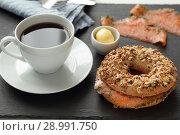 Купить «Salmon bagel sandwich and coffee», фото № 28991750, снято 4 июля 2018 г. (c) Stockphoto / Фотобанк Лори