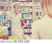 Купить «Seller helping customer to choose care products», фото № 28993226, снято 15 марта 2017 г. (c) Яков Филимонов / Фотобанк Лори