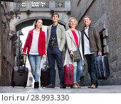 Купить «Portrait of young and mature couple with baggage», фото № 28993330, снято 19 октября 2018 г. (c) Яков Филимонов / Фотобанк Лори