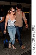 Купить «LeAnn Rimes with her husband Eddie Cibrian at Los Angeles International Airport (LAX) Featuring: LeAnn Rimes, Eddie Cibrian Where: Los Angeles, California...», фото № 28995082, снято 26 апреля 2017 г. (c) age Fotostock / Фотобанк Лори