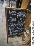 Купить «A sign outside an Asian restaurant in Chelsea in New York on Thursday, March 22, 2018 advertises both Thai and Japanese lunch specials.», фото № 28998298, снято 22 марта 2018 г. (c) age Fotostock / Фотобанк Лори