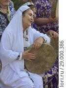 Купить «Pamiri woman performing at the 'Roof of the World' festival in Khorog, Tajikistan.», фото № 29000386, снято 27 июля 2018 г. (c) age Fotostock / Фотобанк Лори