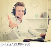 Купить «Portrait of young businessman with headset», фото № 29004950, снято 14 декабря 2019 г. (c) Яков Филимонов / Фотобанк Лори