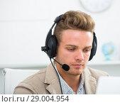 Купить «Portrait of male employee with headset», фото № 29004954, снято 14 декабря 2019 г. (c) Яков Филимонов / Фотобанк Лори