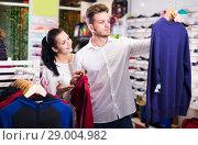 Купить «Adult loving couple deciding on new sportswear», фото № 29004982, снято 22 ноября 2016 г. (c) Яков Филимонов / Фотобанк Лори