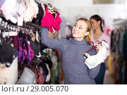 Купить «Woman choosing sexy silky bra», фото № 29005070, снято 22 января 2019 г. (c) Яков Филимонов / Фотобанк Лори