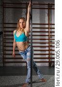 Купить «Woman practicing pole dancing in dark studio», фото № 29005106, снято 10 мая 2018 г. (c) Яков Филимонов / Фотобанк Лори
