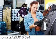 Купить «Girl buying handbag in fashion shop», фото № 29010694, снято 15 сентября 2016 г. (c) Яков Филимонов / Фотобанк Лори