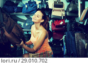 Купить «girl choosing handbag in store», фото № 29010702, снято 15 сентября 2016 г. (c) Яков Филимонов / Фотобанк Лори