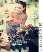 Купить «Girl searching for pair of new shoes», фото № 29010710, снято 15 сентября 2016 г. (c) Яков Филимонов / Фотобанк Лори