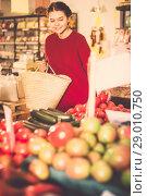 Купить «Girl buys tomatoes», фото № 29010750, снято 1 марта 2017 г. (c) Яков Филимонов / Фотобанк Лори