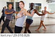 Купить «dancing people practicing vigorous swing», фото № 29010826, снято 30 июля 2018 г. (c) Яков Филимонов / Фотобанк Лори