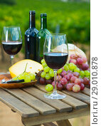 Купить «Red wine, cheese, bread on wooden table», фото № 29010878, снято 25 мая 2019 г. (c) Яков Филимонов / Фотобанк Лори