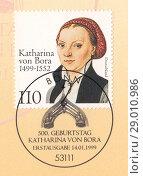 Катарина фон Бора (Katharina von Bora) - жена и ближайшая помощница немецкого церковного реформатора Мартина Лютера. Почтовая марка ФРГ 1999 года. Редакционная иллюстрация, иллюстратор александр афанасьев / Фотобанк Лори