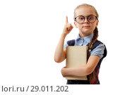 Купить «Девочка в очках держит книгу и показывает пальцем вверх», фото № 29011202, снято 10 августа 2018 г. (c) Иван Карпов / Фотобанк Лори
