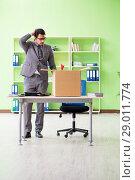 Купить «Male employee collecting his stuff after redundancy», фото № 29011774, снято 14 мая 2018 г. (c) Elnur / Фотобанк Лори