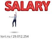 Купить «Businessman flying in salary concept», фото № 29012254, снято 20 сентября 2018 г. (c) Elnur / Фотобанк Лори