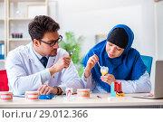 Купить «Dentist doctor and assistant working on new tooth implant», фото № 29012366, снято 24 апреля 2018 г. (c) Elnur / Фотобанк Лори