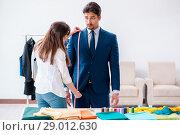 Купить «Professional tailor taking measurements for formal suit», фото № 29012630, снято 30 апреля 2018 г. (c) Elnur / Фотобанк Лори