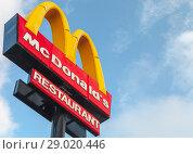 Купить «Mc Donalds restaurant logo under blue sky», фото № 29020446, снято 13 июня 2018 г. (c) EugeneSergeev / Фотобанк Лори