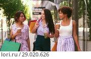 Купить «women with shopping bags and drinks in city», видеоролик № 29020626, снято 15 августа 2018 г. (c) Syda Productions / Фотобанк Лори