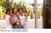 Купить «women with shopping bags looking at shop window», видеоролик № 29020650, снято 15 августа 2018 г. (c) Syda Productions / Фотобанк Лори