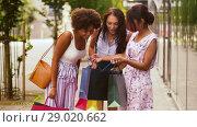 Купить «happy women showing shopping bags in city», видеоролик № 29020662, снято 15 августа 2018 г. (c) Syda Productions / Фотобанк Лори