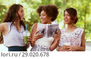 Купить «women with city guide and drinks on street», видеоролик № 29020678, снято 15 августа 2018 г. (c) Syda Productions / Фотобанк Лори