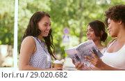 Купить «tourist women with city guide asking for help», видеоролик № 29020682, снято 15 августа 2018 г. (c) Syda Productions / Фотобанк Лори