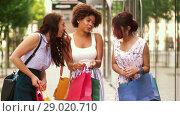Купить «happy women showing shopping bags in city», видеоролик № 29020710, снято 15 августа 2018 г. (c) Syda Productions / Фотобанк Лори