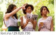 Купить «women with city guide and drinks on street», видеоролик № 29020730, снято 15 августа 2018 г. (c) Syda Productions / Фотобанк Лори