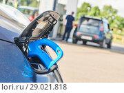 Купить «electric car charging. Ecological automobile», фото № 29021818, снято 6 июля 2018 г. (c) Дмитрий Калиновский / Фотобанк Лори