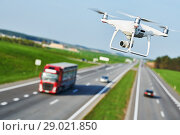 Купить «drone and transportation. drone with camera controls highway road conditions», фото № 29021850, снято 30 апреля 2018 г. (c) Дмитрий Калиновский / Фотобанк Лори