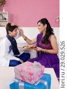Купить «Sister applying tilak to her brother at Raksha Bandhan», фото № 29029526, снято 8 октября 2013 г. (c) easy Fotostock / Фотобанк Лори