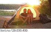 Купить «Travelers in a tent», видеоролик № 29030430, снято 31 августа 2018 г. (c) Илья Шаматура / Фотобанк Лори