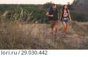 Купить «Couple hiking with backpacks», видеоролик № 29030442, снято 31 августа 2018 г. (c) Илья Шаматура / Фотобанк Лори
