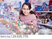 Купить «interested schoolgirl delighted with choosing lollipop in store», фото № 29035770, снято 22 января 2018 г. (c) Яков Филимонов / Фотобанк Лори