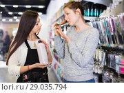 Купить «Young woman hairdresser helping woman client with choice of shampoo in shop», фото № 29035794, снято 31 марта 2018 г. (c) Яков Филимонов / Фотобанк Лори