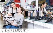 Купить «hairdresser edvise woman client about samples of hair dye», фото № 29035814, снято 31 марта 2018 г. (c) Яков Филимонов / Фотобанк Лори