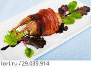 Купить «Baked in bacon small quail with balsamic sauce, served with lettuce», фото № 29035914, снято 18 июня 2019 г. (c) Яков Филимонов / Фотобанк Лори