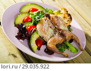 Купить «Image of quail-tobacco with sesame which served with salad of avocado and greenery», фото № 29035922, снято 21 октября 2018 г. (c) Яков Филимонов / Фотобанк Лори