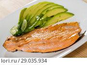 Купить «Photography of plate with fried trout fillet with avocado», фото № 29035934, снято 14 декабря 2019 г. (c) Яков Филимонов / Фотобанк Лори