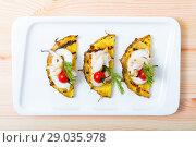 Купить «Image of sepia fried on a grill with pineapple, cherry tomatoes and sauce Chile», фото № 29035978, снято 17 октября 2018 г. (c) Яков Филимонов / Фотобанк Лори