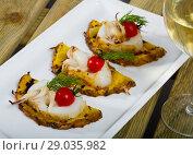 Купить «Image of sepia fried on a grill with pineapple, cherry tomatoes and sauce Chile», фото № 29035982, снято 17 октября 2018 г. (c) Яков Филимонов / Фотобанк Лори