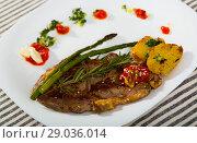 Купить «Roasted veal steak with baked vegetables, adjika and garlic sauce», фото № 29036014, снято 27 июня 2018 г. (c) Яков Филимонов / Фотобанк Лори