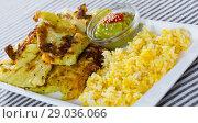 Купить «Leaves of cabbage in batter with rice and green pea sauce», фото № 29036066, снято 16 октября 2018 г. (c) Яков Филимонов / Фотобанк Лори