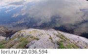 Купить «Сlouds are reflected in the water Norwegian fjord in sunny day, Averoy, Norway», видеоролик № 29036594, снято 1 сентября 2018 г. (c) Некрасов Андрей / Фотобанк Лори