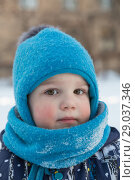 Купить «Child boy 2-3 years in winter outside in blue knitted woollen hat with pompon and scarf-snood. Close-up portrait, looking at camera», фото № 29037346, снято 21 марта 2018 г. (c) Юлия Бабкина / Фотобанк Лори
