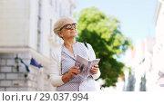 Купить «senior woman or tourist walking with city guide», видеоролик № 29037994, снято 21 августа 2018 г. (c) Syda Productions / Фотобанк Лори